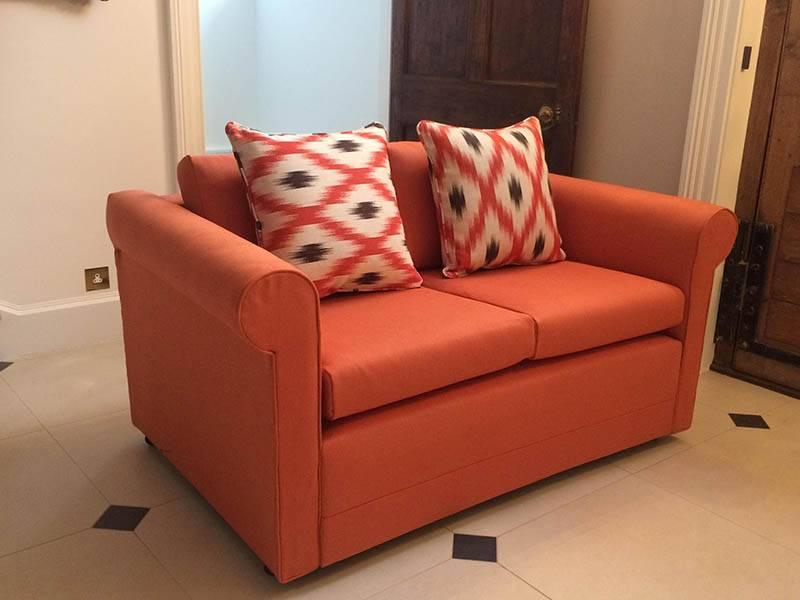 orange sofa in room