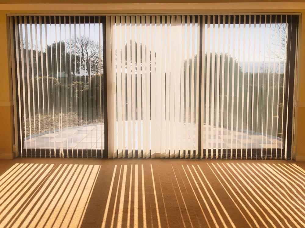 vertical blinds next to doorway