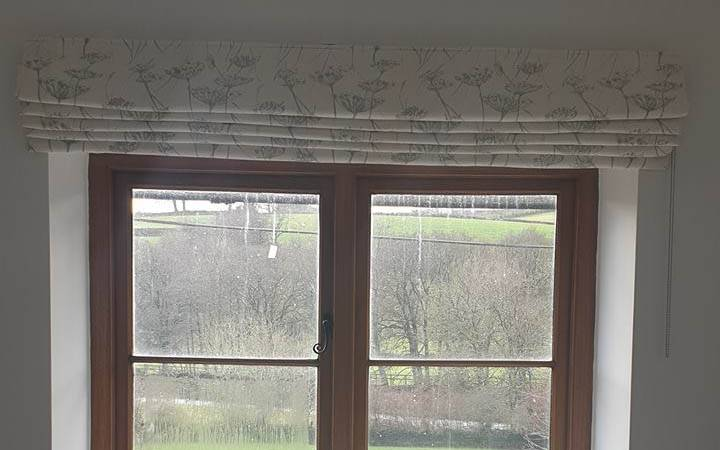 roman blinds from in a house